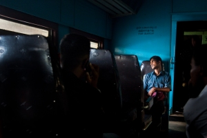 Man riding a train in Sri Lanka.